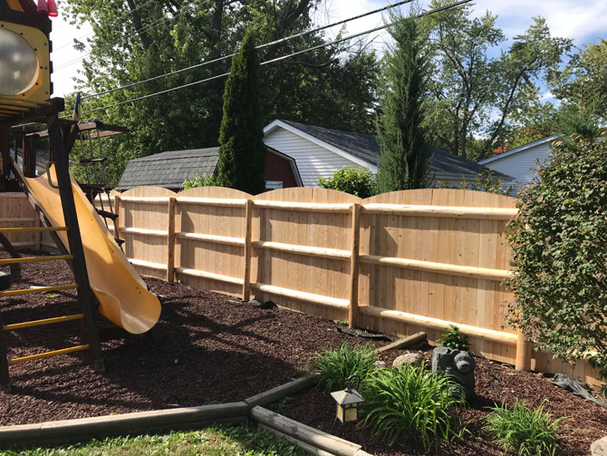 Wood Fence - Cut Arch Privacy Log Fence Installation in Tinley Park IL