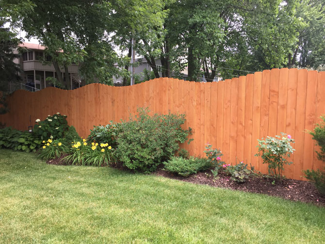 Wood Fence - Privacy Arch Stained Fence installed in Orland Park IL